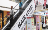 Escalator-Branding-at-Alphaone-Mall